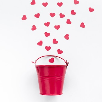Flat lay of bucket with hearts