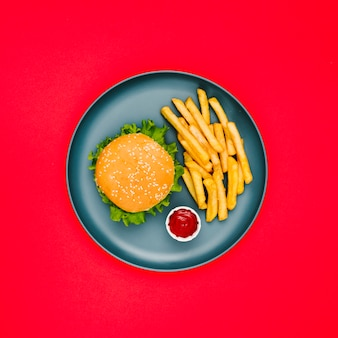 Flat-lay burger and fries on plate