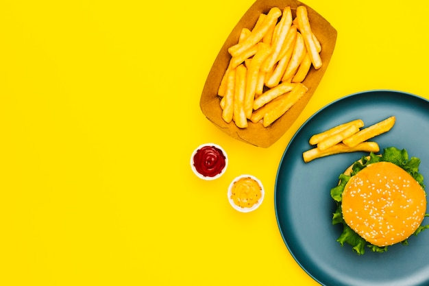 Flat-lay burger and fries with copyspace