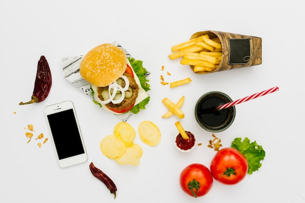 Flat-lay burger and fries with soda