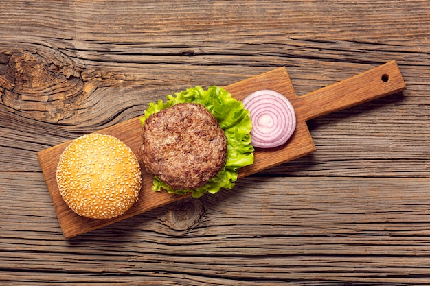 Flat lay burger ingredients on a cutting board