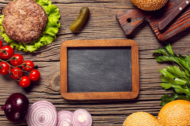 Flat lay burger ingredients with chalkboard