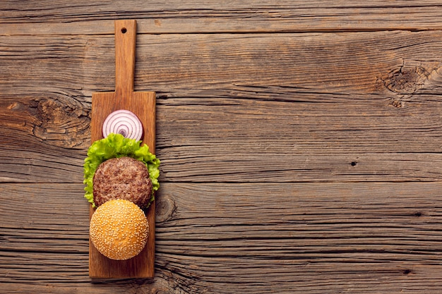 Flat lay burger ingredients with copy space