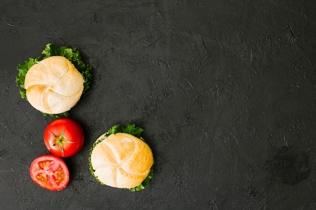 Flat-lay burger on slate with copyspace