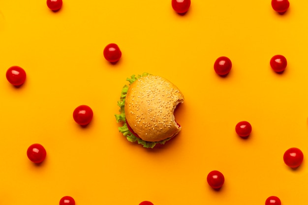 Flat lay burger with cherry tomatoes