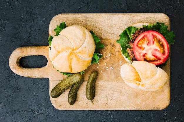 Flat lay burger on wooden board