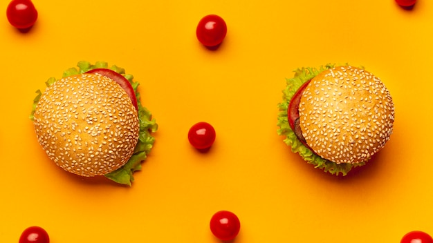 Flat lay burgers on orange background