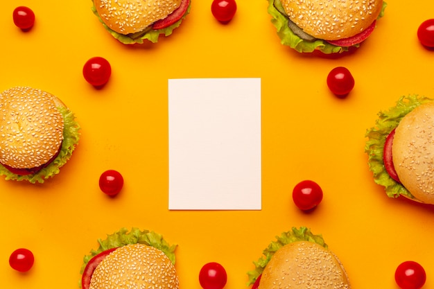 Flat lay burgers with copy space