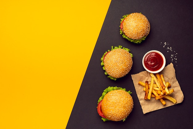 Flat lay burgers with french fries
