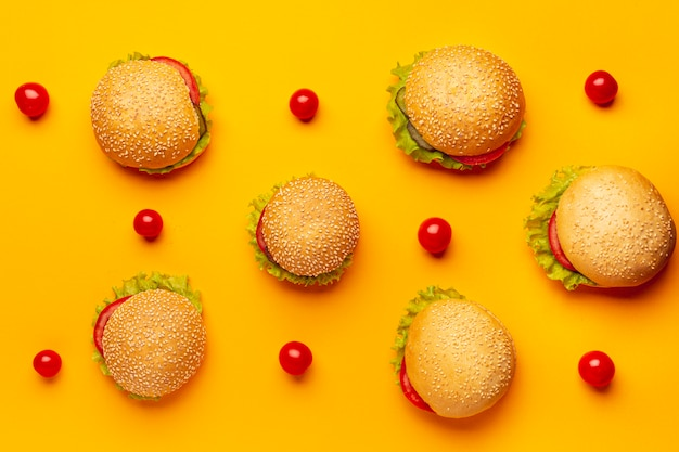 Flat lay burgers with orange background