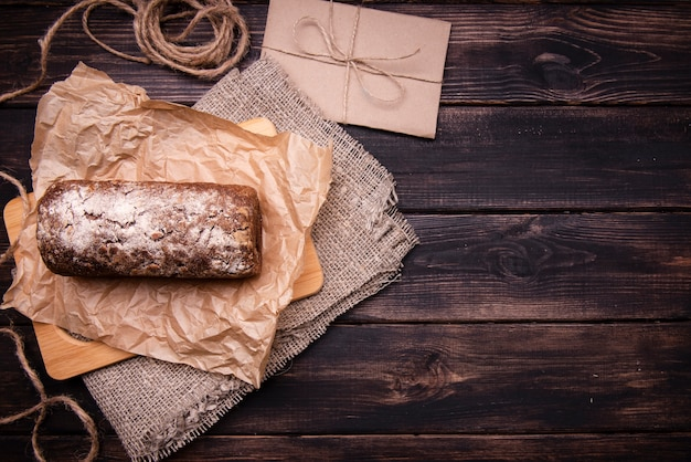 Flat lay of cake on parchment paper and cloth