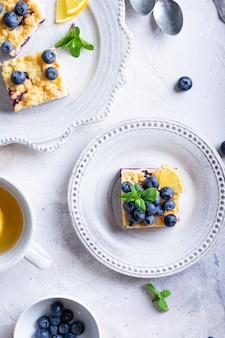 Flat lay of cake with blueberries and cottage cheese