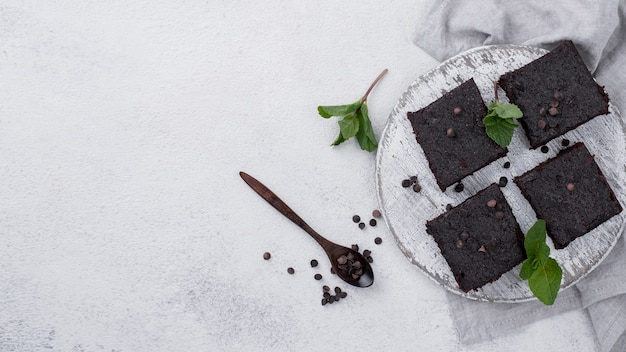 Flat lay of cake with mint and spoon