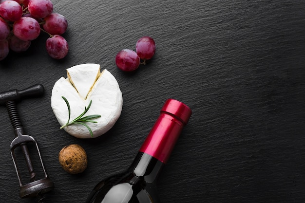 Flat lay camembert grapes and wine with copy space