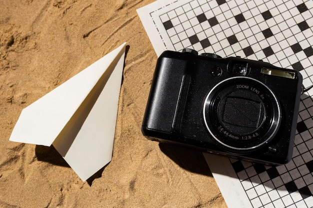 Flat lay camera and paper plane