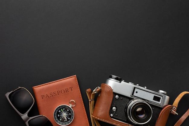 Flat lay camera and passport arrangement