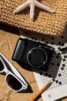 Flat lay camera and travel bag arrangement