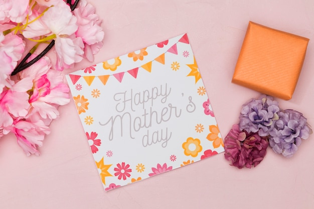 Flat lay of card and flowers for mothers day with present