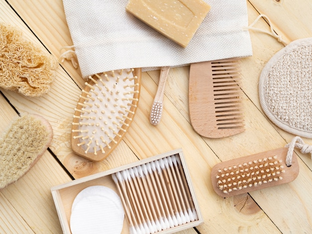 Flat lay care products on wooden table