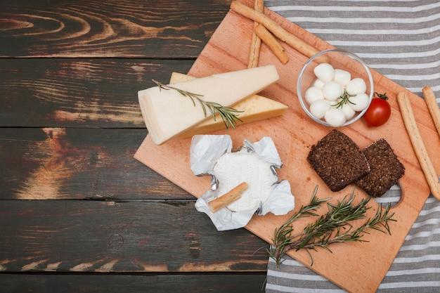 Flat lay cheese composition with copyspace