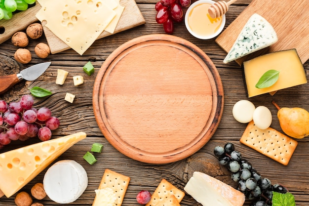 Flat lay cheese mix  with wooden cutting board