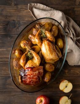 Flat lay chicken and potatoes dish