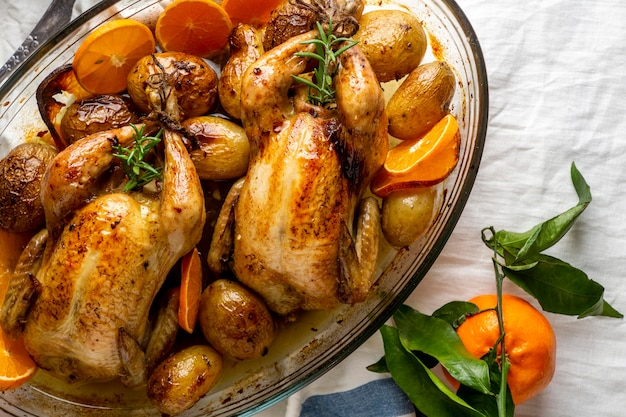 Flat lay chicken with potatoes and orange