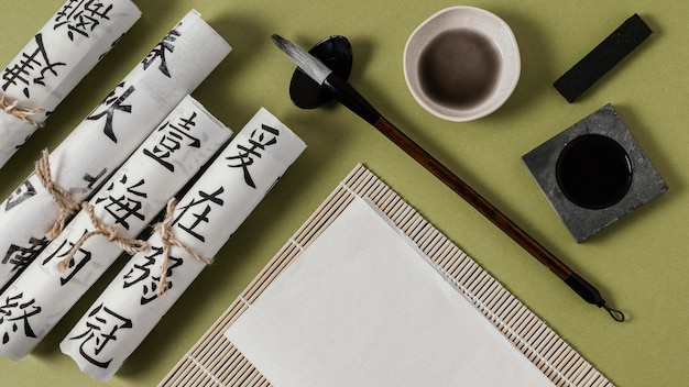 Flat lay chinese ink with empty paper arrangement