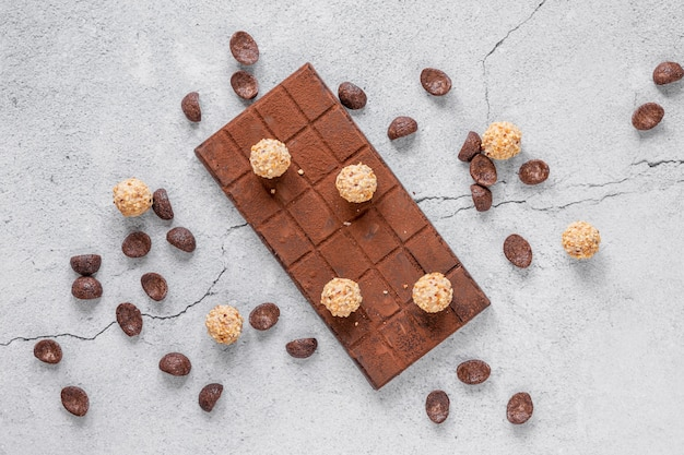 Flat lay chocolate assortment on light background