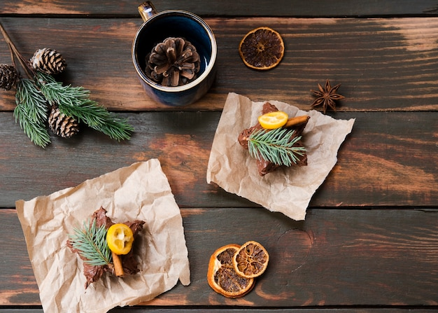 Flat lay of chocolate covered pastry with dried citrus