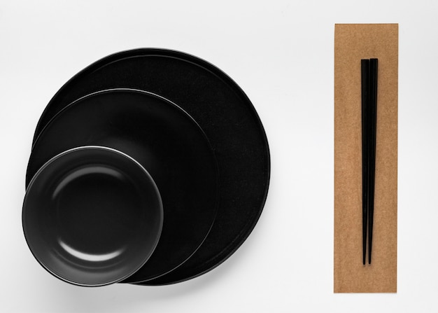 Flat lay of chopsticks with dinnerware
