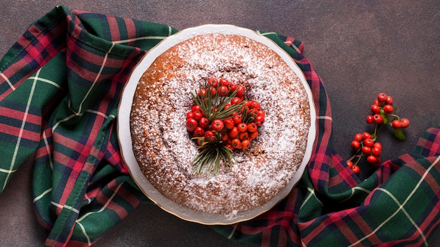 Flat lay of christmas cake with red berries