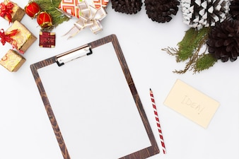 Flat lay christmas clipboard mockup. Christmas ideas, notes Merry christmas happy new year