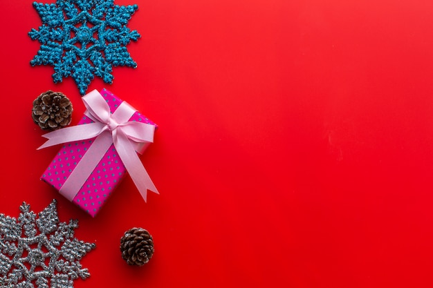 Flat lay of christmas composition  on red background. christmas, winter,  . copyspace and soft focus.