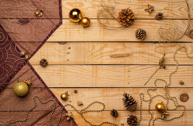 Flat lay of christmas decorations on a wooden texture