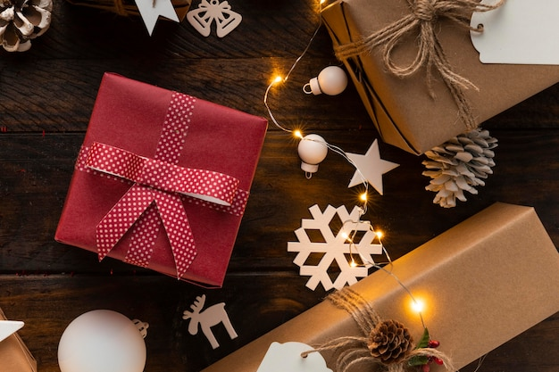 Flat lay of christmas gifts on wooden table