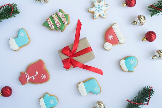 Flat lay of christmas gingerbread and gift box on the white background. top view.