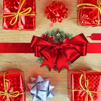 Flat lay of christmas ornaments and gift boxes on a wooden table