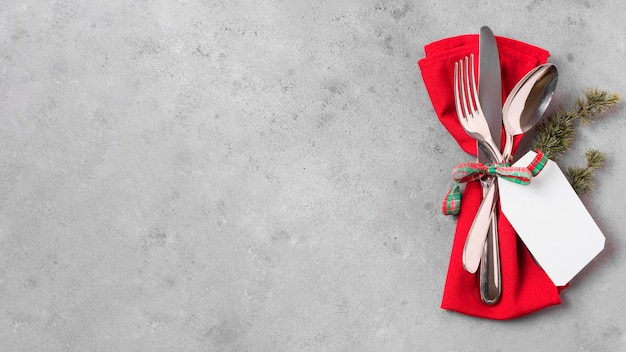 Flat lay of christmas table arrangement with copy space and cutlery