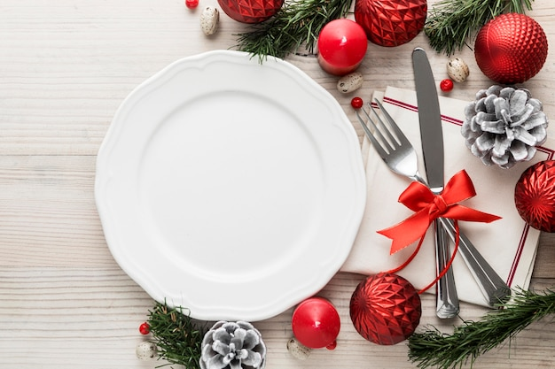 Flat lay christmas tableware with empty plate