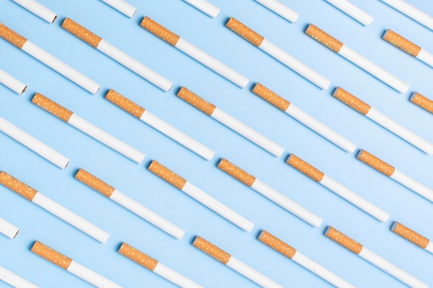 Flat lay cigarettes on blue background