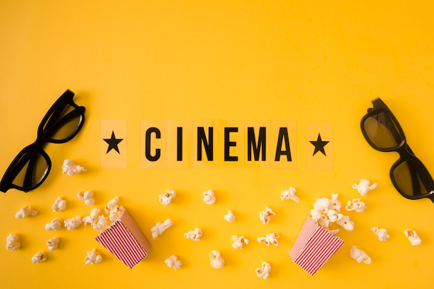 Flat lay cinema lettering on yellow background