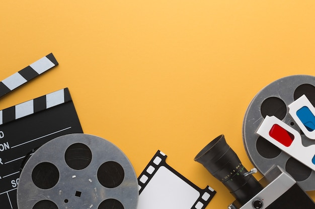 Flat lay cinema objects on yellow background