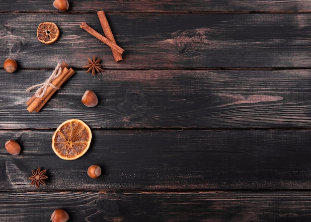 Flat lay of cinnamon sticks with chestnuts