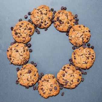 Flat lay circular chocolate chip cookies frame