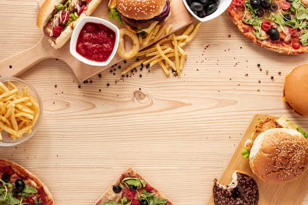 Flat lay circular frame with delicious fast food