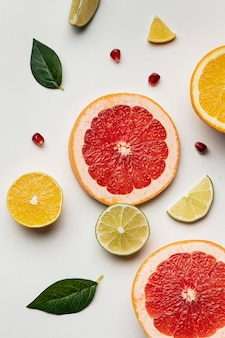 Flat lay of citrus with leaves