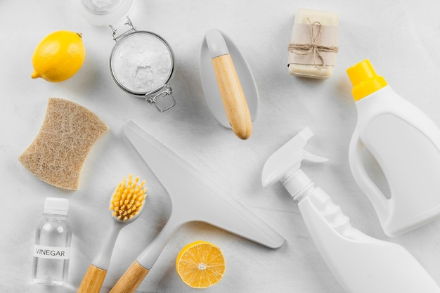 Flat lay of cleaning products with lemon and baking soda