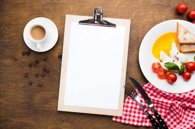 Flat lay clipboard mockup on breakfast table