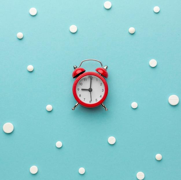 Flat lay clock shape of pills